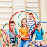 Kids with hula hoops — Stock Photo