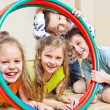 Children with  hula hoops - Stock Photo