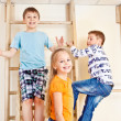 Children climbing wall bars — Stock Photo