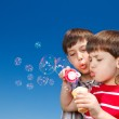 Boys blowing bubbles — Stock Photo #11633437
