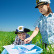 Boys playing with paper boats — Stock Photo #11633463