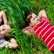 Kids lying on grass — 图库照片