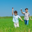 Kids playing with paper airplanes — Stock Photo #11633491