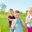 Kids group with toy water guns — Stock Photo