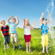 Stock Photo: Kids enjoying water splashes
