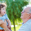 Stock Photo: Great granddad and baby