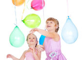 Siblings playing with balloons — Stock Photo