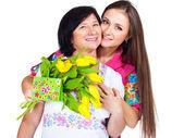Daughter greeting mom — Stock Photo