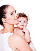 Mother and sweet curly baby in diaper — Stock Photo