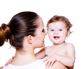 Woman holding baby — Stock Photo