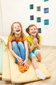 Girls sit on tumbling mats — Stock Photo