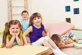 Kids on tumbling mats — Stock Photo