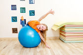 Girl on a gymnastic ball — Stock Photo