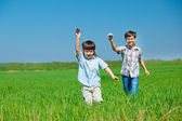 Kids playing with paper airplanes — Stock Photo