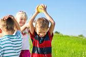 Kids spraying water — Stok fotoğraf