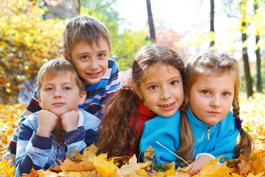 Two boys and two girls in autumn park — Stock Photo #11631271