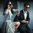 Stock Photo: Young, smiling couple wearing sunglasses