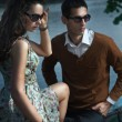 Young, smiling couple wearing sunglasses - Stockfoto