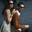 Young couple wearing sunglasses - Stock Photo
