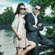 Young, smiling couple wearing sunglasses — Stock Photo #11708127