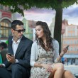 Royalty-Free Stock Photo: Handsome couple with mobile