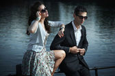 Young, smiling couple wearing sunglasses — Stock Photo