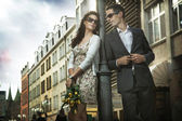 Adorable couple on the middle of a promenade — Stockfoto