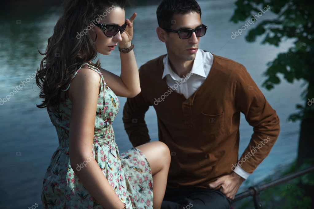 Young, smiling couple wearing sunglasses  Stock Photo #11704032