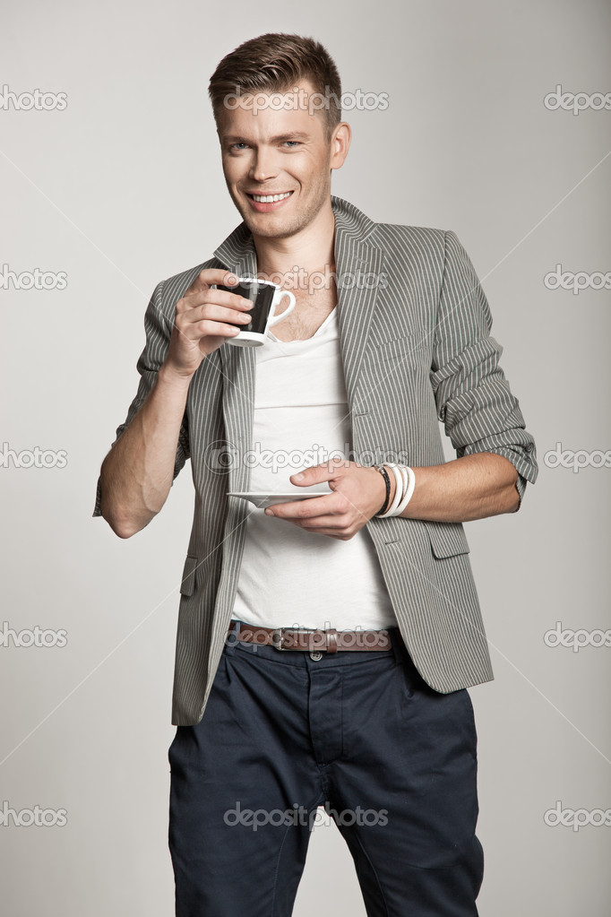 Happy mature man having a beverage — Stock Photo #11734613