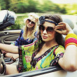 Smiling women in a cabriolet — Stock Photo