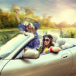 Smiling women in a cabriolet — Stock Photo #11741999