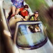 Young having fun in cabriolet — Stockfoto