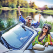 Smiling women in a cabriolet — Stock Photo #11742132