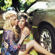 Two women next to the car - 