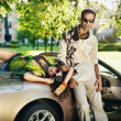 Young couple in cabriolet — Stock Photo #11746210