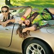 Handsome couple in cabriolet — Stock Photo