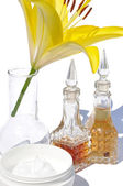 Yellow lily and oil — Stock Photo
