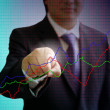 Businessman point the graph on virtual board - Stock Photo