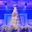 Wedding cake with stage lighting — Stock Photo