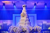 Wedding cake with stage lighting — Stock Photo