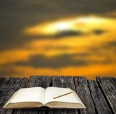 Open notebook at evening with sunset sky — Stock Photo
