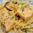 Spaghetti with Salmon in Japanese style - Stock Photo