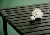 Shuttle cock on wooden table, Badminton sport concept — Stockfoto