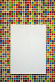 Blank paper board on colorful mosaic wall — Stock Photo