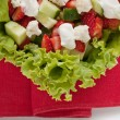 Green salad with cucumber, zucchini and strawberries — Stock Photo