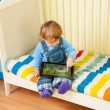 Kid playing with tablet pc — Stockfoto