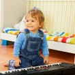 Boy playing a composer — Stock Photo