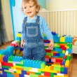 Kid playing with toy blocs — Stock Photo
