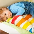Tired toddler laying in his bed — Stock Photo