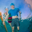 Couple swimming together — Stock Photo